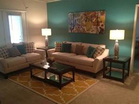 teal and yellow living room with sectional sofa and white