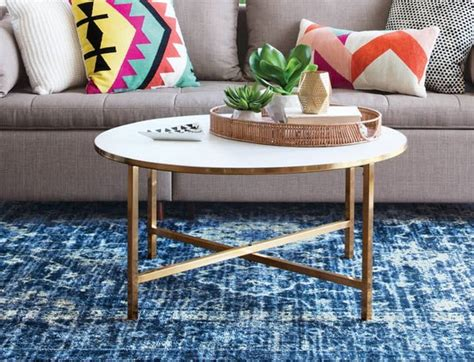 Your coffee table is the center of your living room. Ideas For How to Style a Round Coffee Table | Apartment Therapy