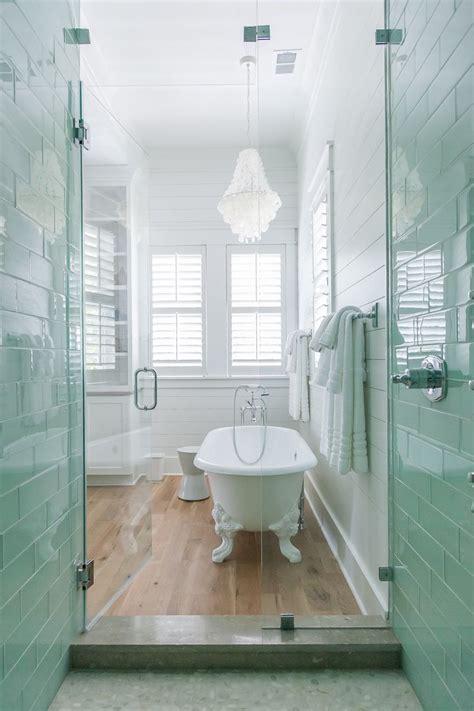 coastal master bathroom  white oak floors claw foot