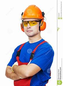 Builder In Hard Hat  Earmuffs And Goggles Stock Photo