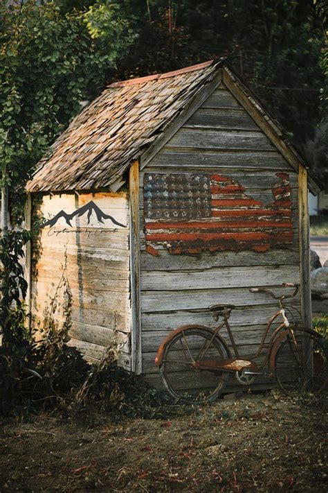 rustic wood shed weathered shed american flag country