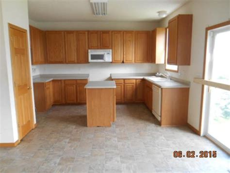 what color wood floor goes with oak cabinets help what should i do with these oak cabinets i