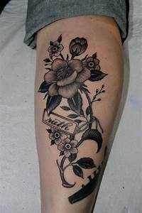 Black flowers as calf tattoo design