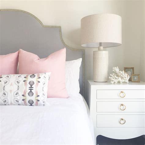 gray headboard  pink pillows contemporary bedroom