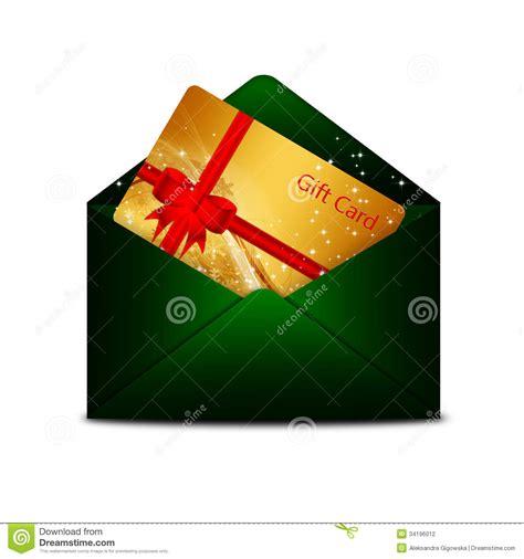 christmas gift card in green envelope over white stock