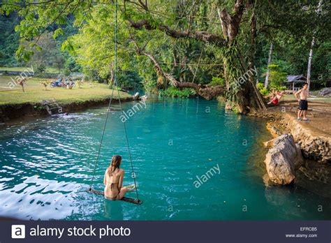 Woman On A Swing In The Blue Lagoon Vang Vieng Laos