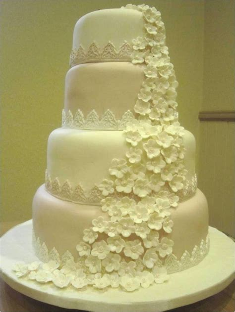 4 tier wedding cake emers wedding cake blossoms cascade with lace borders i 1112