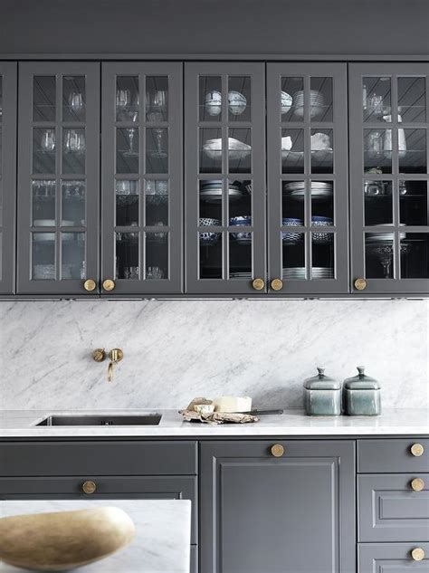gray kitchen cabinets  gold knobs contemporary kitchen