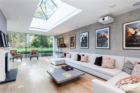 Contemporary Skylights Living Room With Grey Wallpaper Leather Sofas And Sectionals