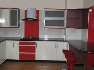 white and red wooden counter with black top added by white With modular kitchen designs red white