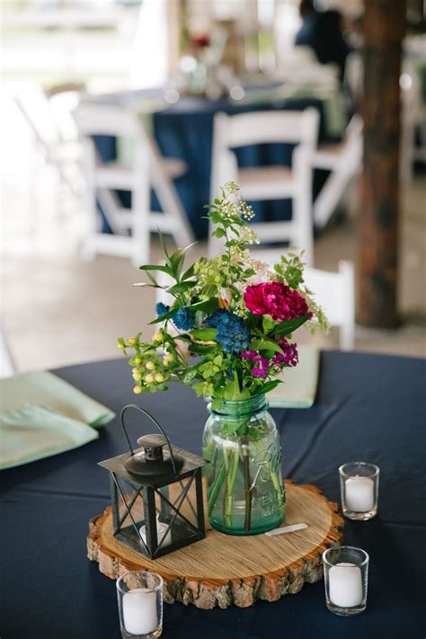 diy wooden slab centerpieces  jars  flowers