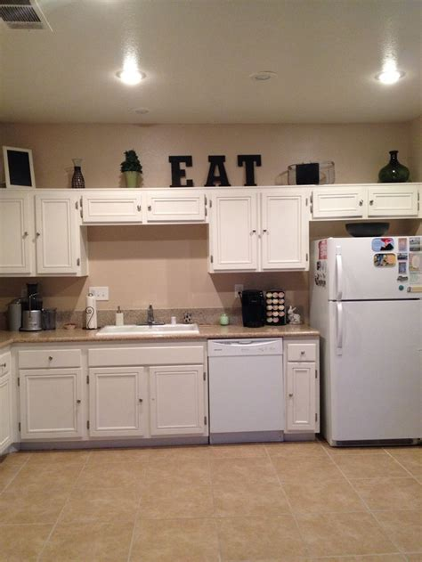 How To Decorate Above Kitchen Cupboards by My Kitchen White Cupboard Above Cabinet Decor