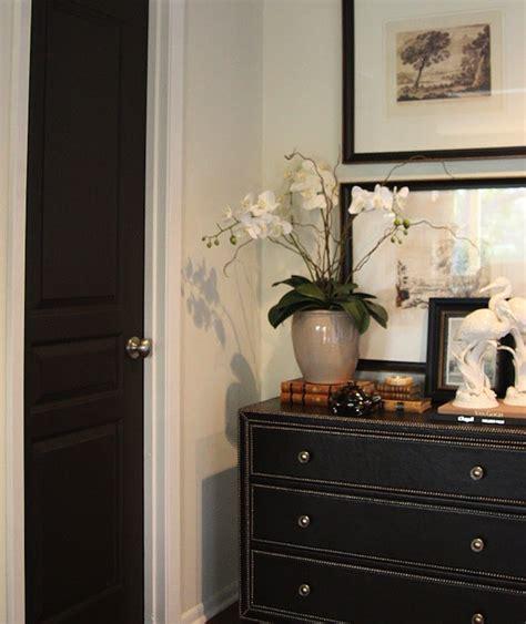 black paint color transitional entrance foyer