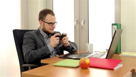 desk games to play at work a bad employee playing video games at work stock footage