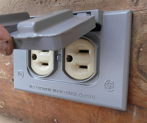 outdoor light with electrical outlet saving money with diy how to replace an outdoor outlet cover