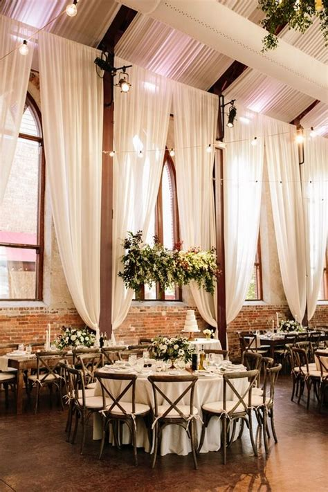 romantic wedding reception with ivory draping Roses