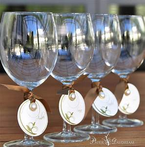 take your wine glass to the table to claim your seat With wine glass wedding favors