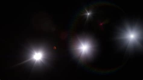 seeing flashes of white light spiritual flashes white camera flashes over black background