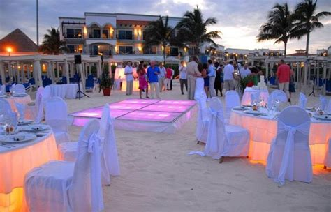 beach wedding reception light up dance floor and tables