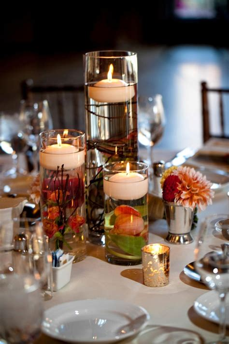 floating candle wedding centerpiece  submerged flowers