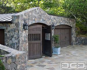 Automatic motorized carriage doors custom made in a tuscan for Automatic carriage garage doors