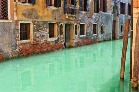 Green Water In A Venetian Canal Stock Photo Image Of