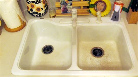 how to remove a kitchen sink spring cleaning removing black marks from a white kitchen