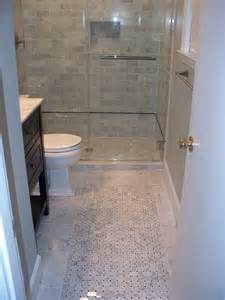 Bathroom Floor Tile Ideas 2015 by Swank White Swing Door Bathroom With Wooden Vanity In