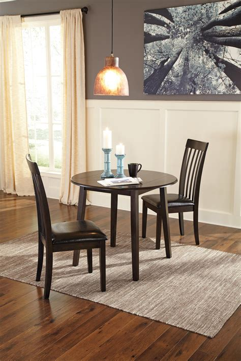 dining room drop leaf table  signature design  ashley wolf furniture