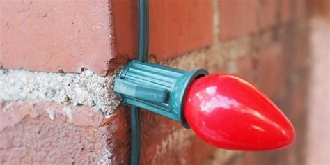 christmas lights on stucco how to use glue to fasten christmas lights to brick or