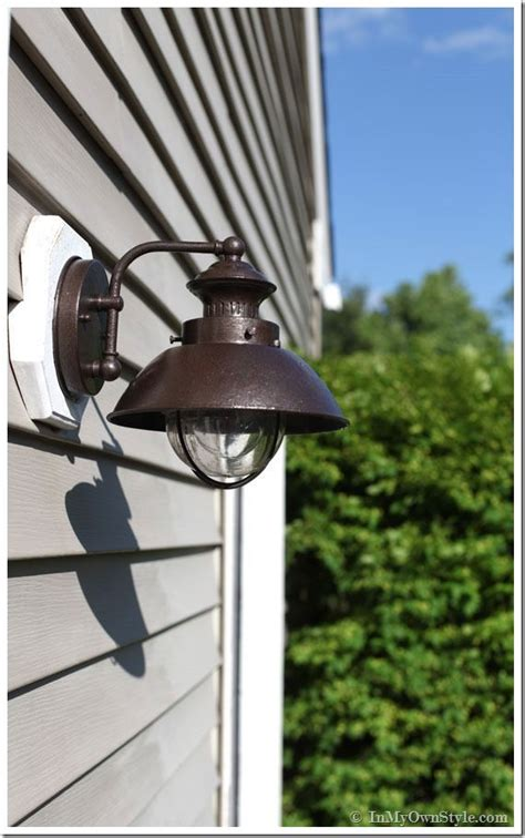 outdoor light fixture makeover using metallic paint