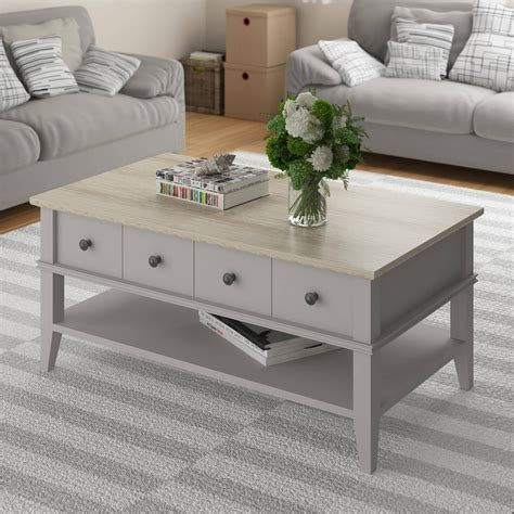 For family game night, have board games easily accessible if your coffee table with storage has an open shelf, consider displaying vases or sculptures as a decorative touch. 30 Inspirations of Light Oak Coffee Tables With Drawers