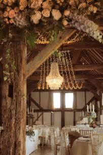 crystal wedding chandelier with a fairy light canopy at