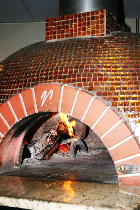 Open wood fired pizza oven! #glass tile www