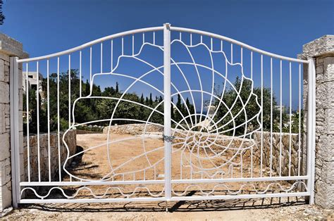 Wrought iron entrance gate   Alberto Artuso ? Corfu Architect