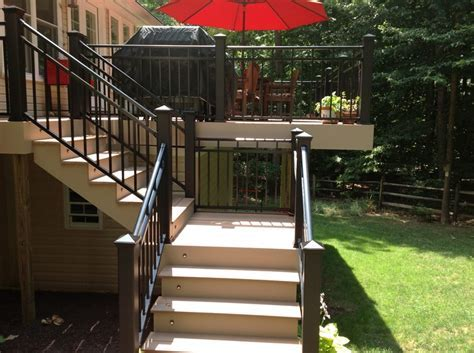 Split #deck staircase with black aluminum railing