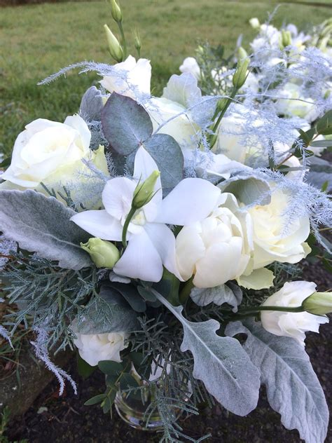 winter wedding flowers white silver table arrangements