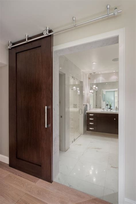 barn door style wood door  bathroom hgtv