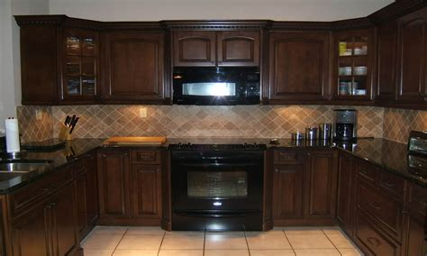 with dark brown cabinets cream cabinets with dark brown