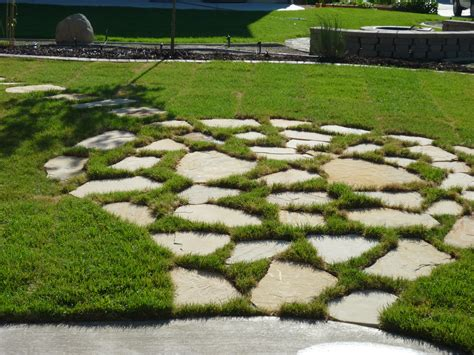 flagstone patio in grass chris landscaping in