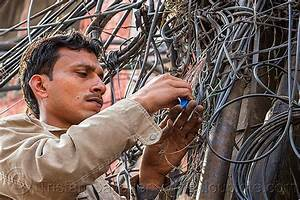 Man Installing Telephone Wiring  India