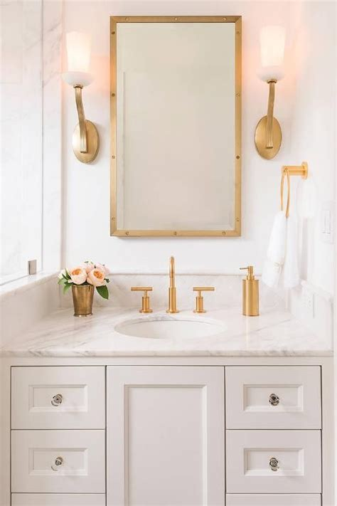 Silver Bathroom Cabinet by 18 Gorgeous Marble Bathrooms With Brass Gold Fixtures