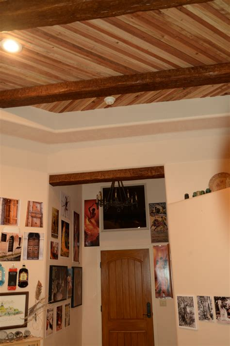 accenting  plank ceiling  beams faux wood workshop