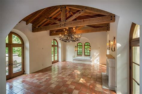 gorgeous spanish inspired room  wood beams terra cotta floors  stucco walls cool
