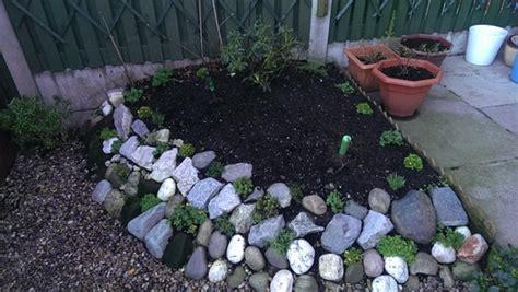 built  rockery   small garden    sun