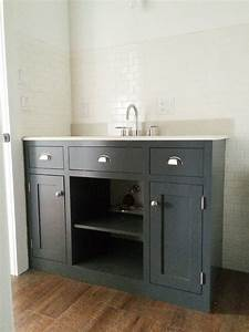 How to make diy pallet bathroom vanity projects for Making a bathroom cabinet