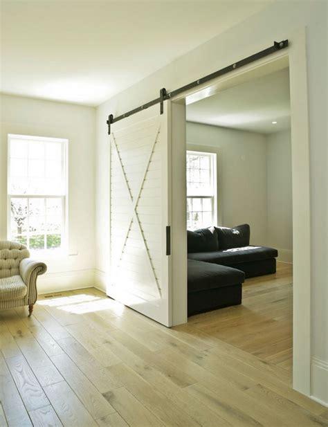 white barn door bringing sliding barn doors inside