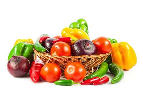 white wicker baskets fresh vegetables in basket isolated on white bio
