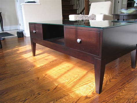 A glass top coffee table is an easy way to create a trendy look. Glass-Top Coffee Table - Canadian Wood Design