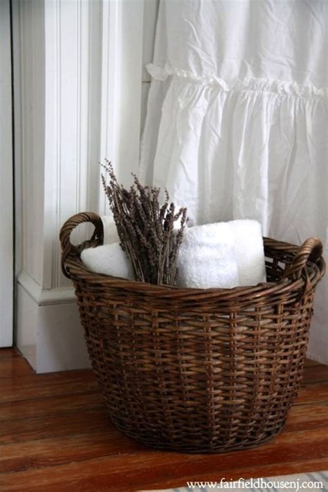 bathroom basket ideas vintage wicker basket backed by crispest white towels